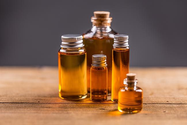 Bottles of cbd hemp oil extracts on wooden table