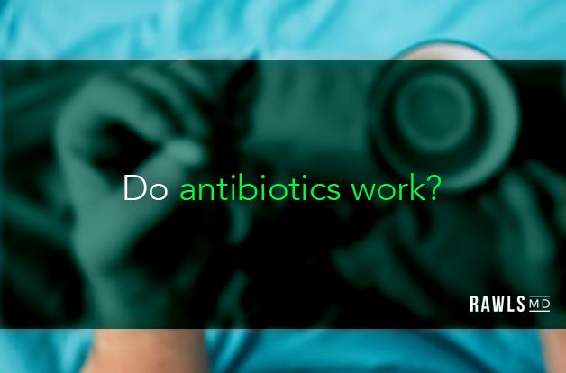 Do antibiotics work? Hands holding a pill and cup of tea background