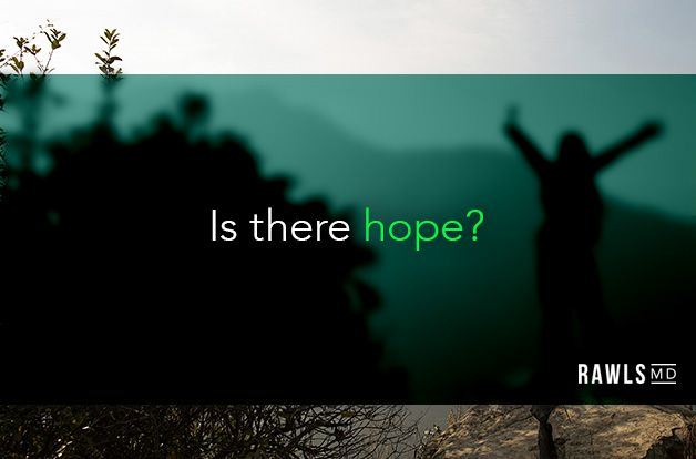 Is there hope? Hands up in air, freedom stance, on mountain background