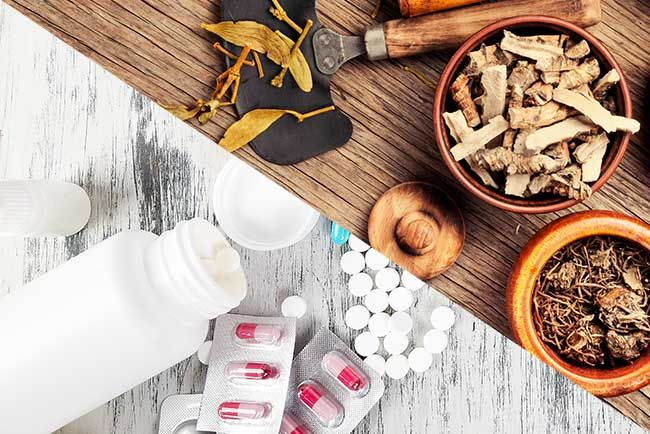 Alternative remedies and traditional pills. Natural medicine vs conventional medicine concept.