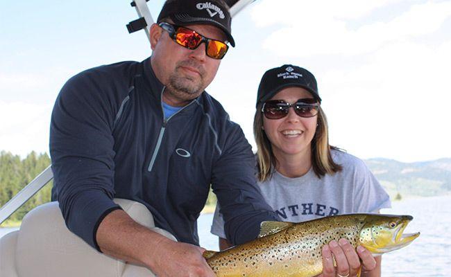 Jennifer and her husband on the lake catching fish
