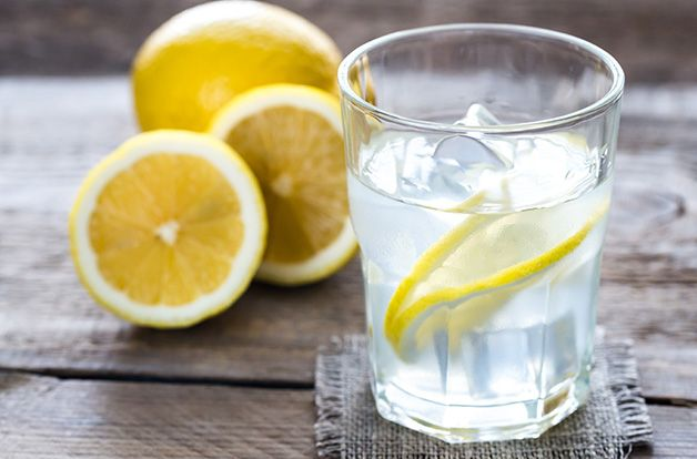 glass of water with fresh lemon juice for detox
