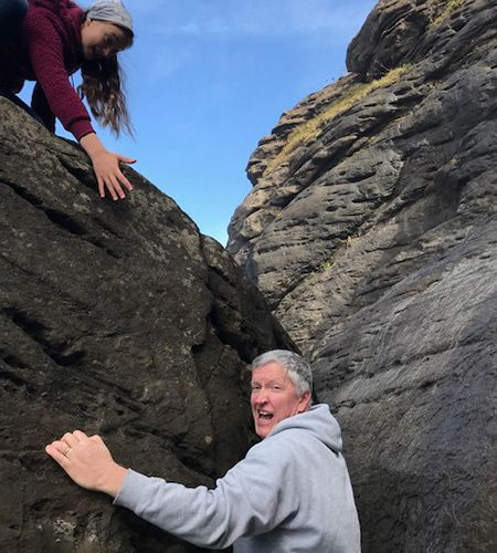 Brad Riegg reaching for help while climbing