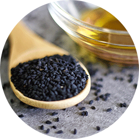 black cumin seeds in wooden spoon