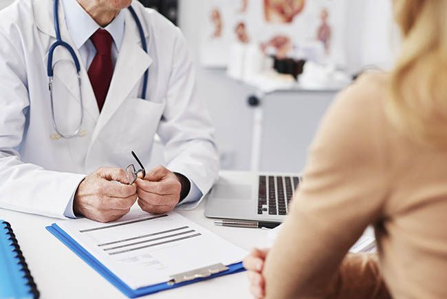 Close up of patient and doctor in doctor's office