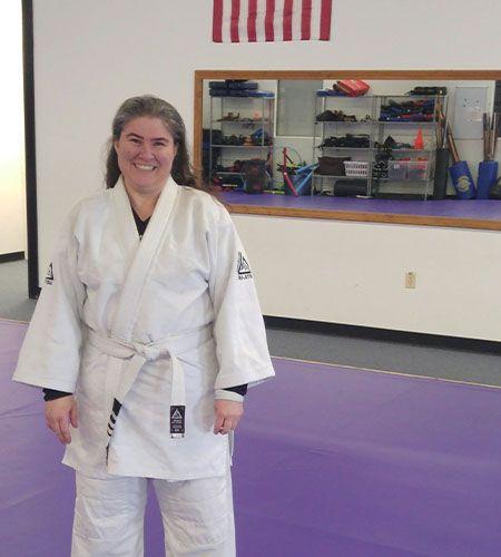 Trish at taekwondo, dressed in uniform
